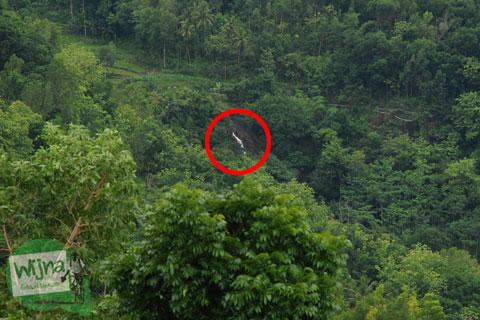 Curug Banyunibo terlihat dari Embung Nglanggeran Pathuk Gunungkidul, Yogyakarta di Hari Natal