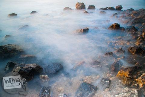 Contoh penggunaan filter ND dan CPL untuk memotret slow speed sunset laut di Pantai Lhoknga, Aceh setelah Bencana Tsunami