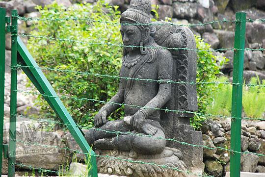 arca buddha penunggu candi risan semin gunungkidul yang lokasinya di dekat pintu masuk