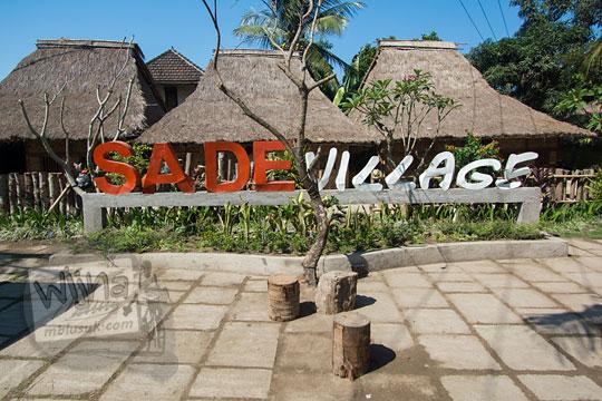 papan nama modern desa adat sade lombok