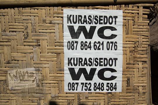 kertas iklan jasa sedot wc di desa adat sade lombok