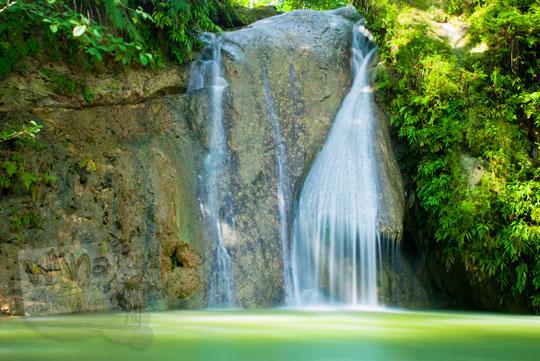 air terjun kecil (curug) bernama Kedung Pengilon yang masih sepi dan tersembunyi di Dusun Petung, Bangunjiwo, Kasihan, Bantul, Yogyakarta